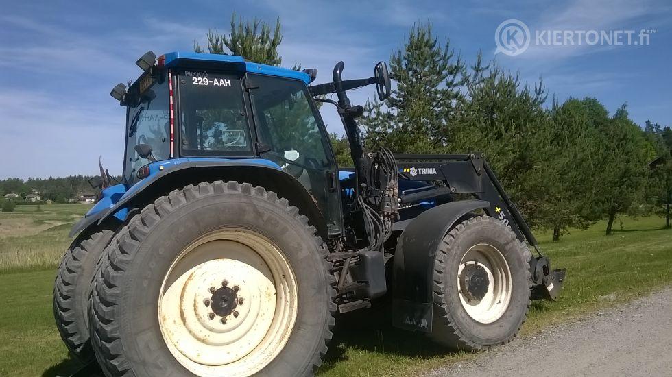 Traktori New Holland TM150+lumikauha+alueaura+hiekoituskauha