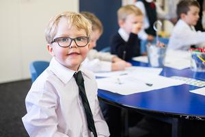 Boy with glasses smiling
