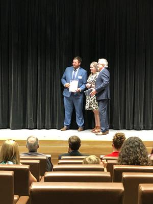 Lachlan receiving his Augustus Alt Prize from NSW Surveyor General Narelle Underwood
