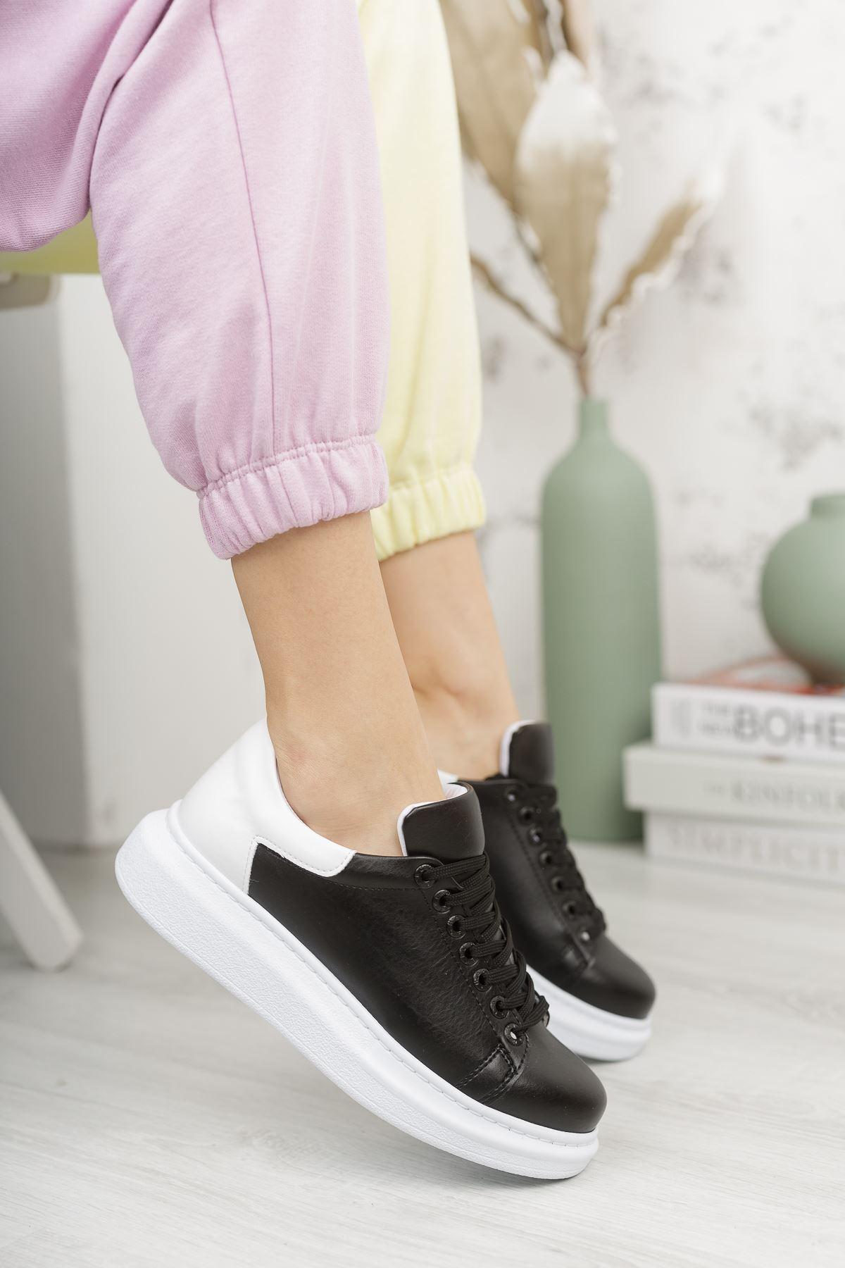حذاء رياضة أبيض أسود برباط نسائي