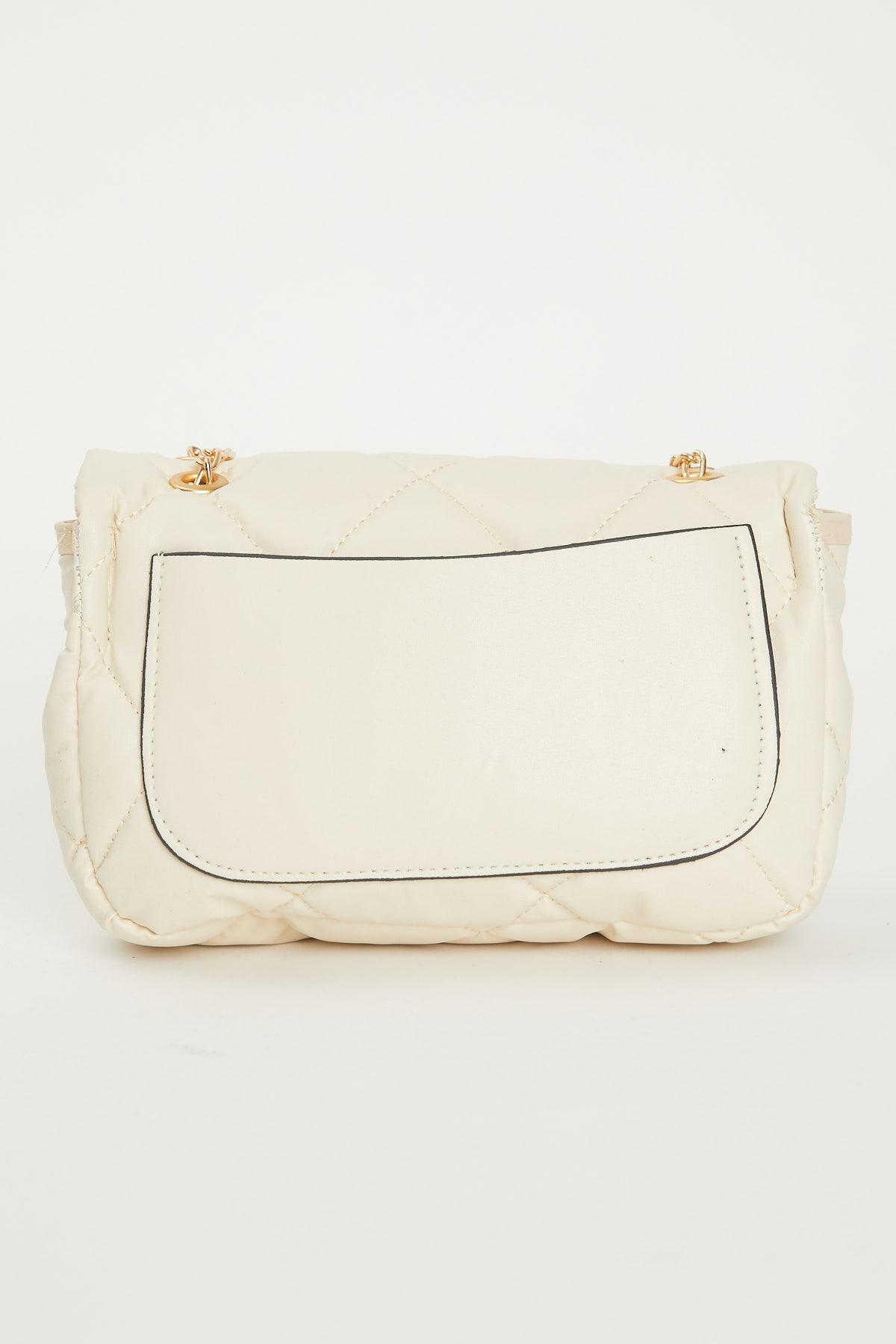 حقيبة كروس بودي مبطنة كريمي مفصلة بسلسلة نسائية
