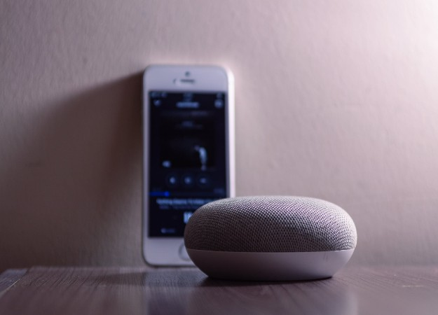 https://www.pexels.com/photo/gray-google-home-mini-beside-silver-iphone-5s-1279365/