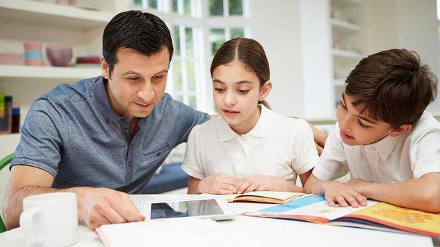 Parent helping children with homework 1280x720.jpg