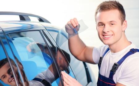 Man tinting car windows