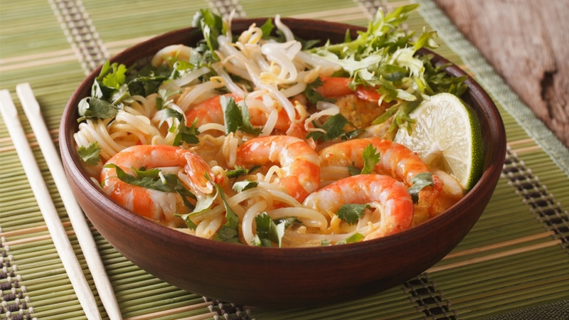 A bowl of curry laksa with shrimp. This dish is popular in Malaysia.