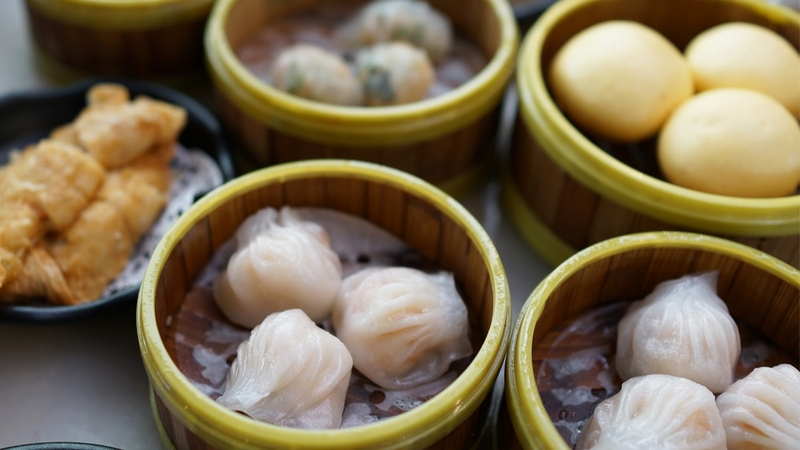 Four bowls of dim sum on a table.