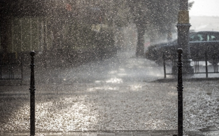 A heavy rain that is causing streets to flood.