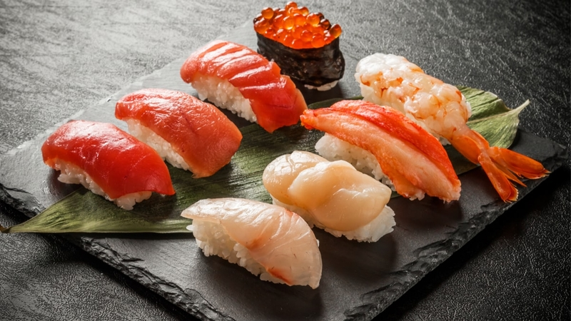A plate of a variety of sushi.
