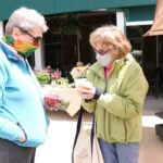 Lakewood Retirement Community friends picking up Farmer Market Produce at Earth Day Celebration