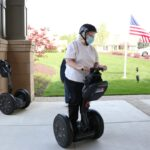 Lakewood Independent Living female residents riding on Segway courtesy of RVA on Wheels.