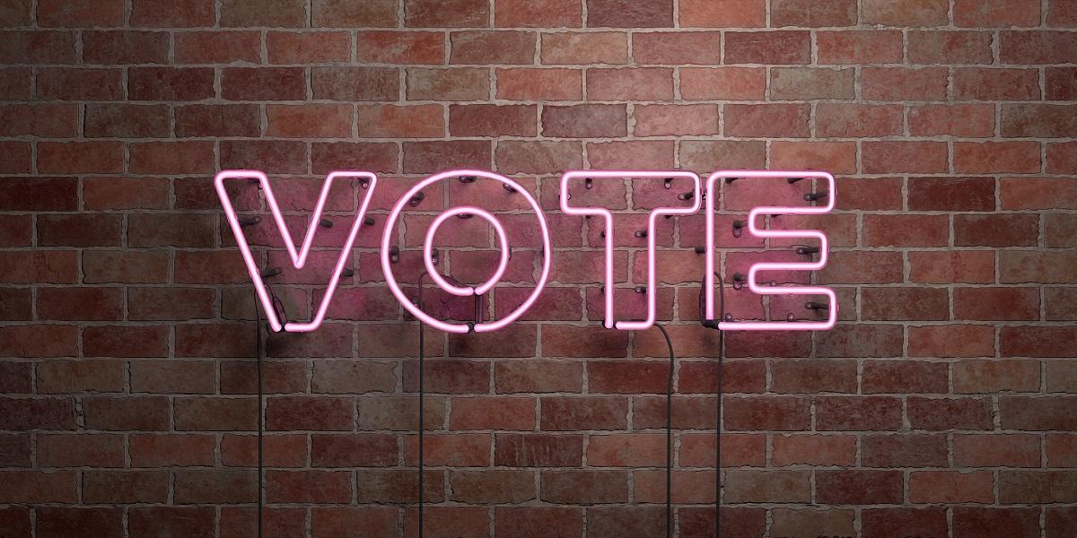 VOTE - fluorescent Neon tube Sign on brickwork