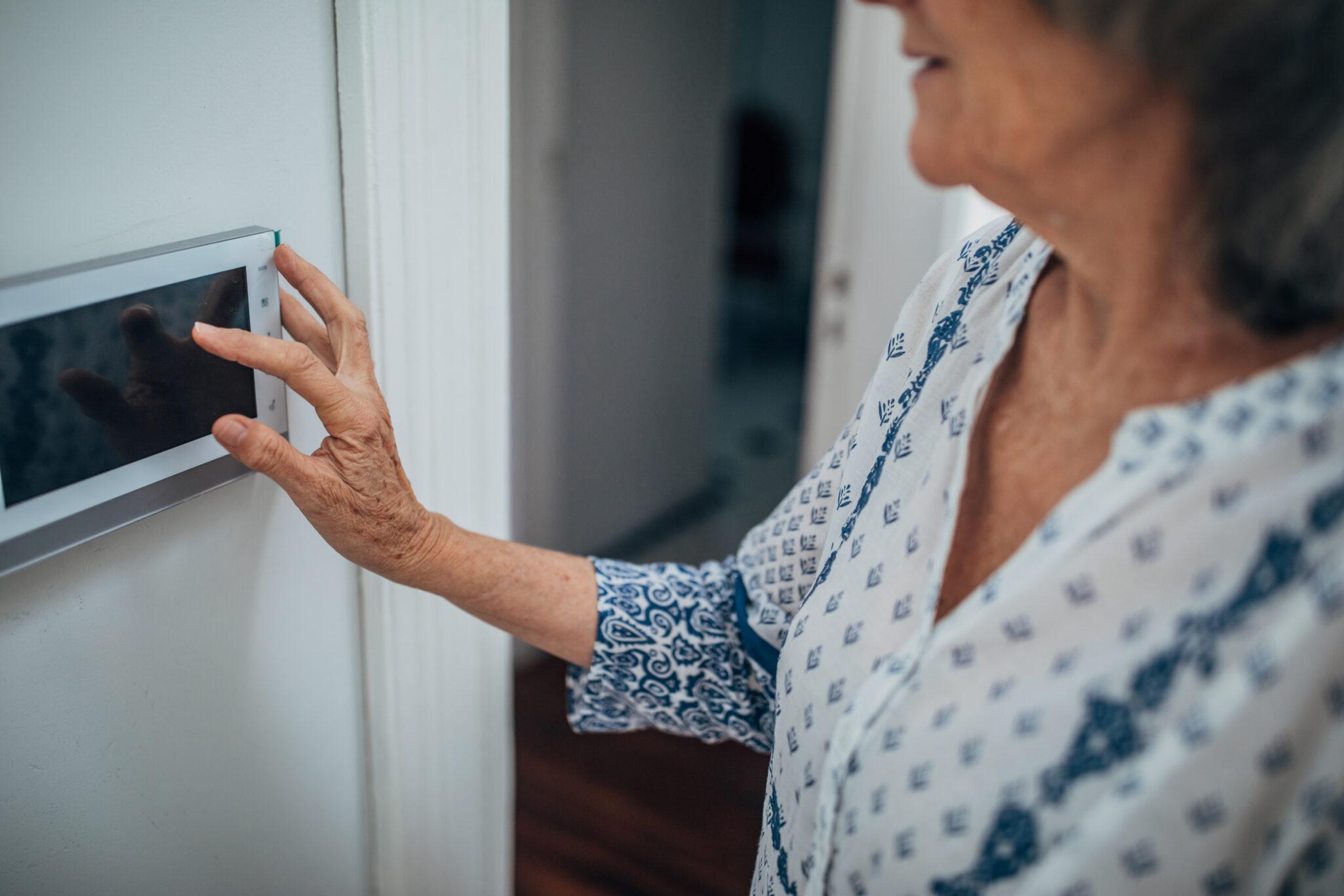 Senior lady using home automation