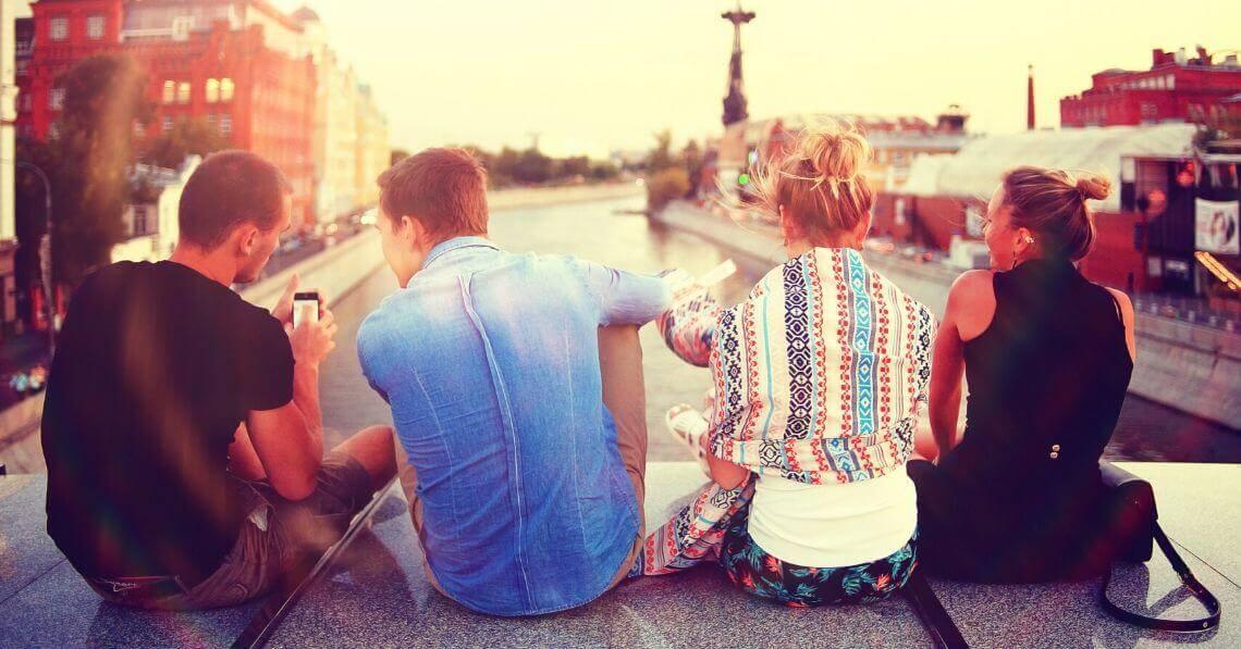 Friends talking on a bridge