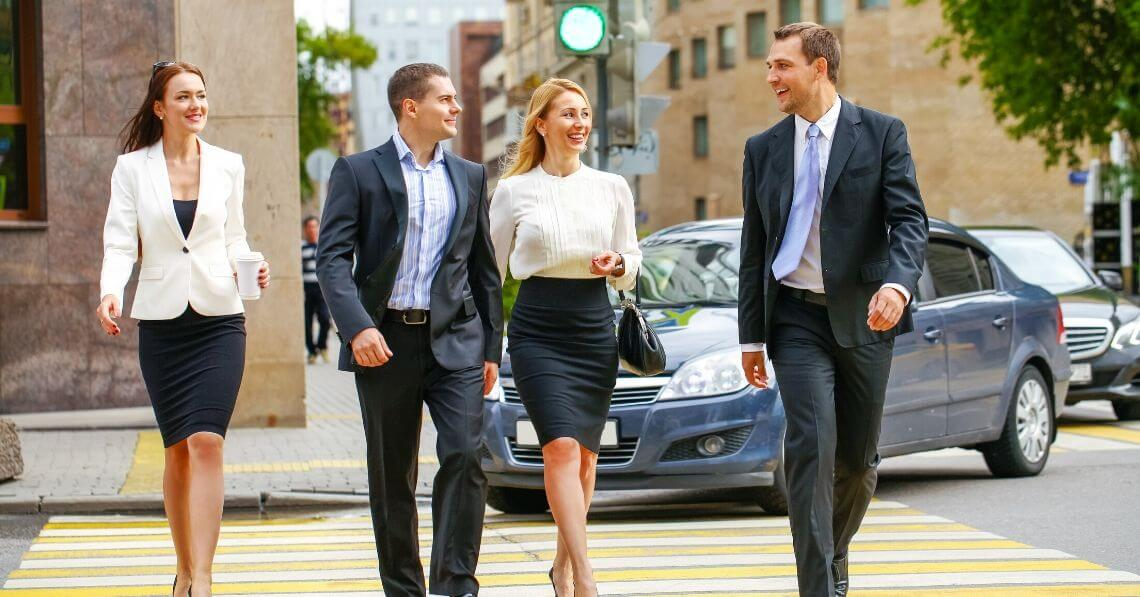A group of business people crossing the street