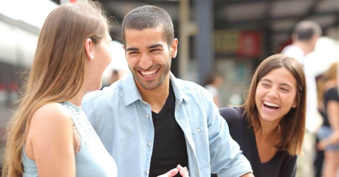 A man smiling at his girlfriend
