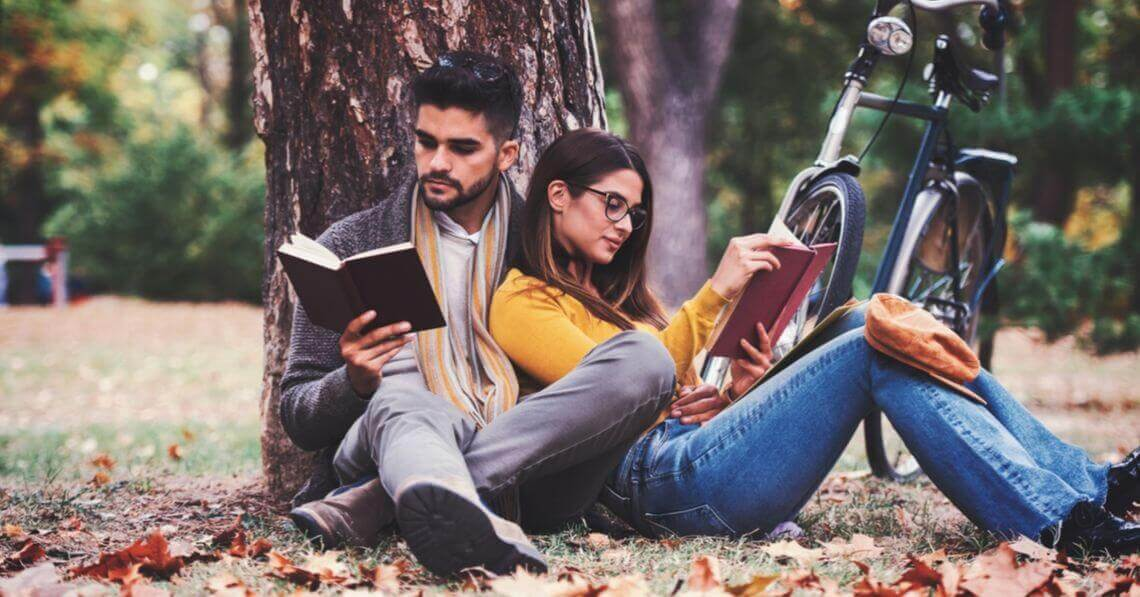 A couple reading their books in the nature