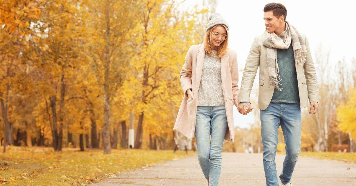 A couple holding hands, taking a walk
