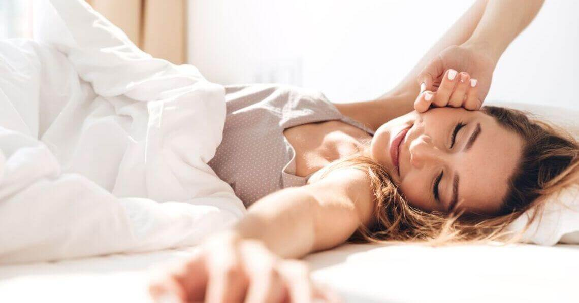 Happy young woman waking up