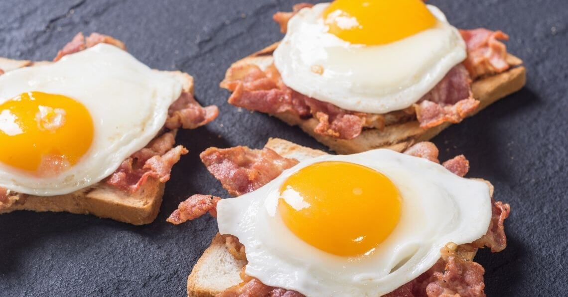 Bacon and eggs over bread