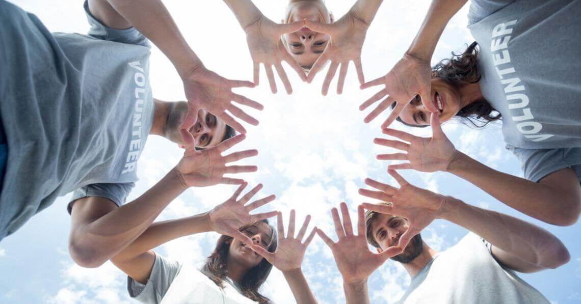 A group of people putting their hand together