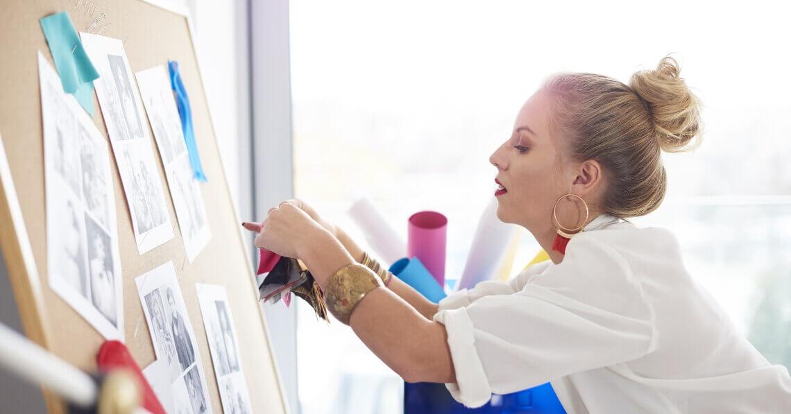 Woman organizing her pin board
