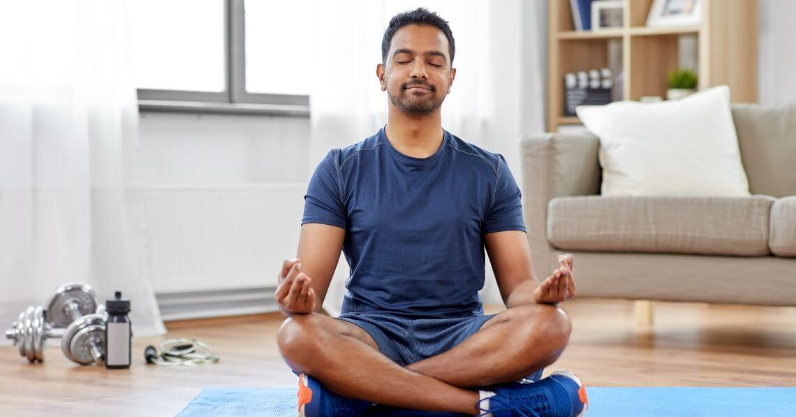 Young man meditating before working out