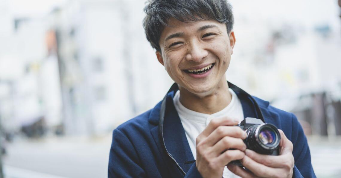 Smiling man enjoying photography hobby