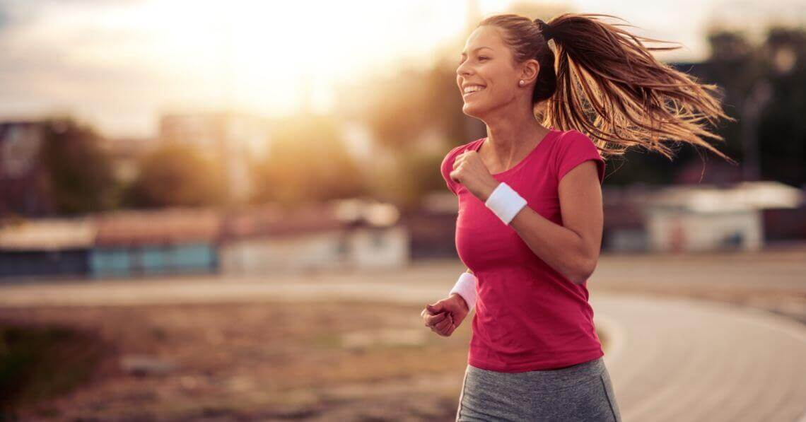 Smiling young woman running