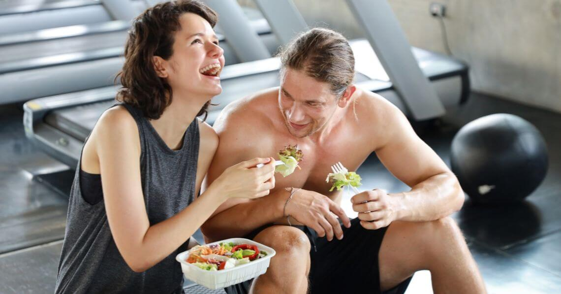 A happy couple having luncg after workout