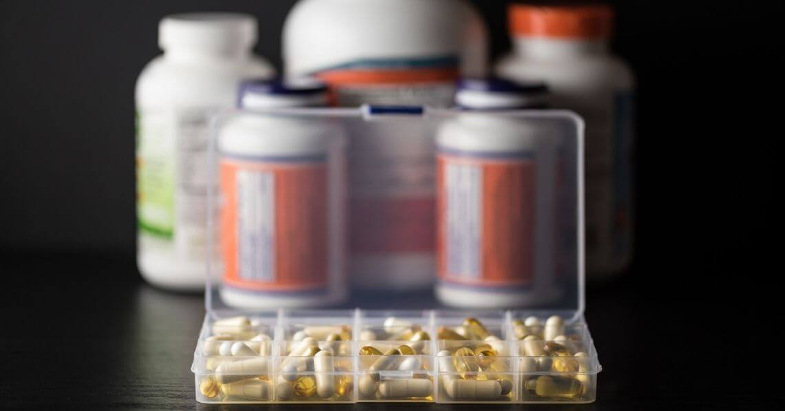Supplement pills in a 5-day organizer