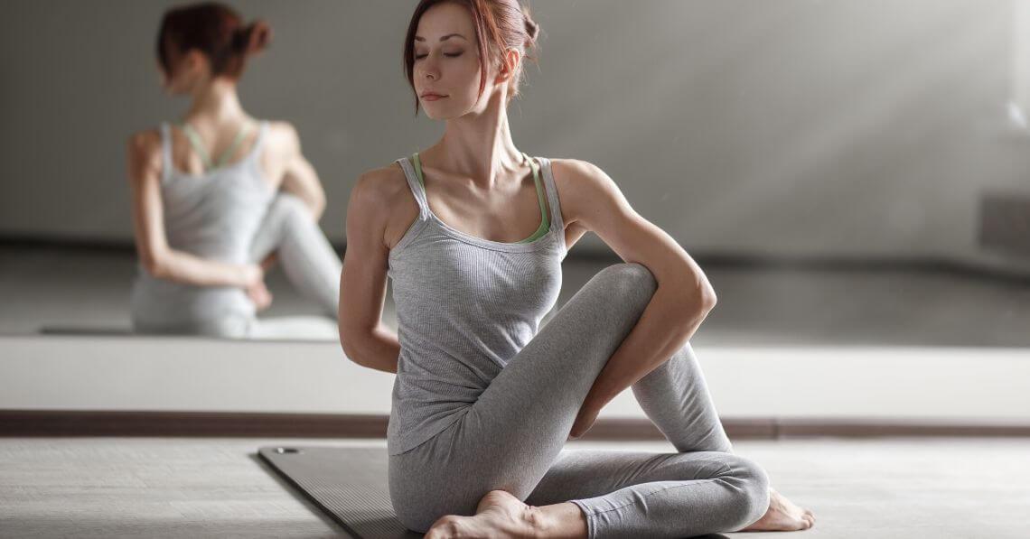 Woman in a studio doing yoga