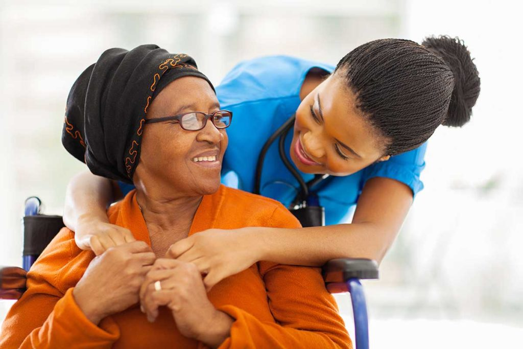 Senior woman and her caregiver in an assisted living community