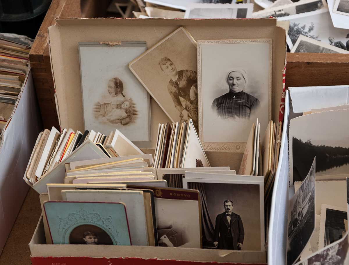 Paris, France - March 10, 2013: Old black and white and sepia photos at flea market. There are more than 20 flea markets in Paris.
