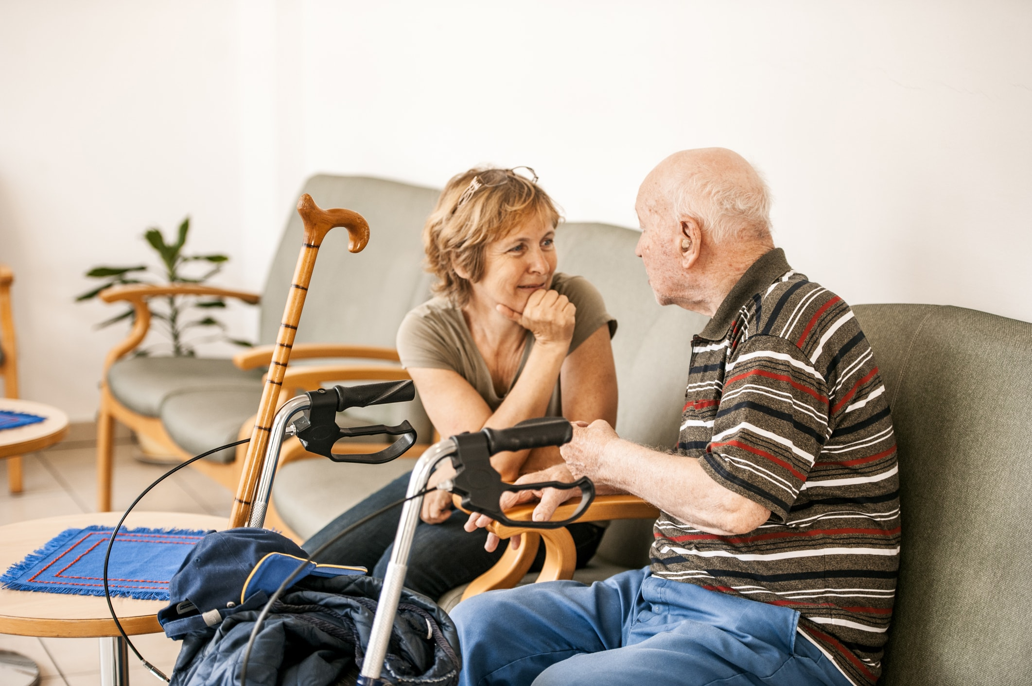 Elderly couple sitting on a couch having a discussion