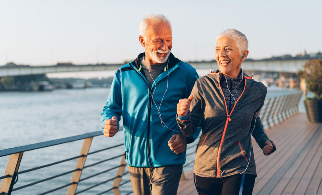 an elderly couple taking a walk to get exercise