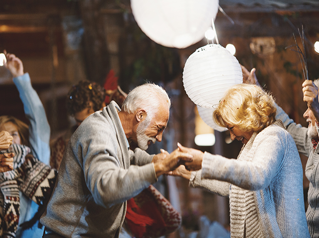 a senior couple dancing with one another