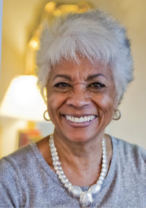 a senior woman smiling for the camera