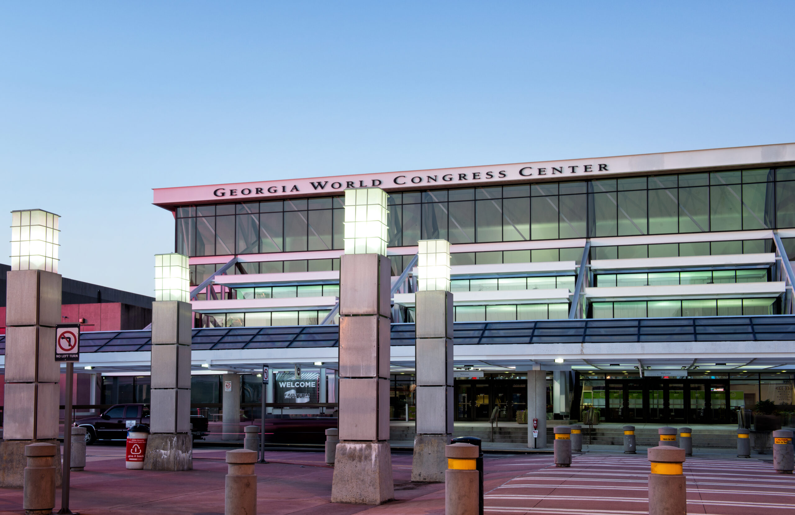 Georgia World Congress Center main entrance with sign at Twilight.