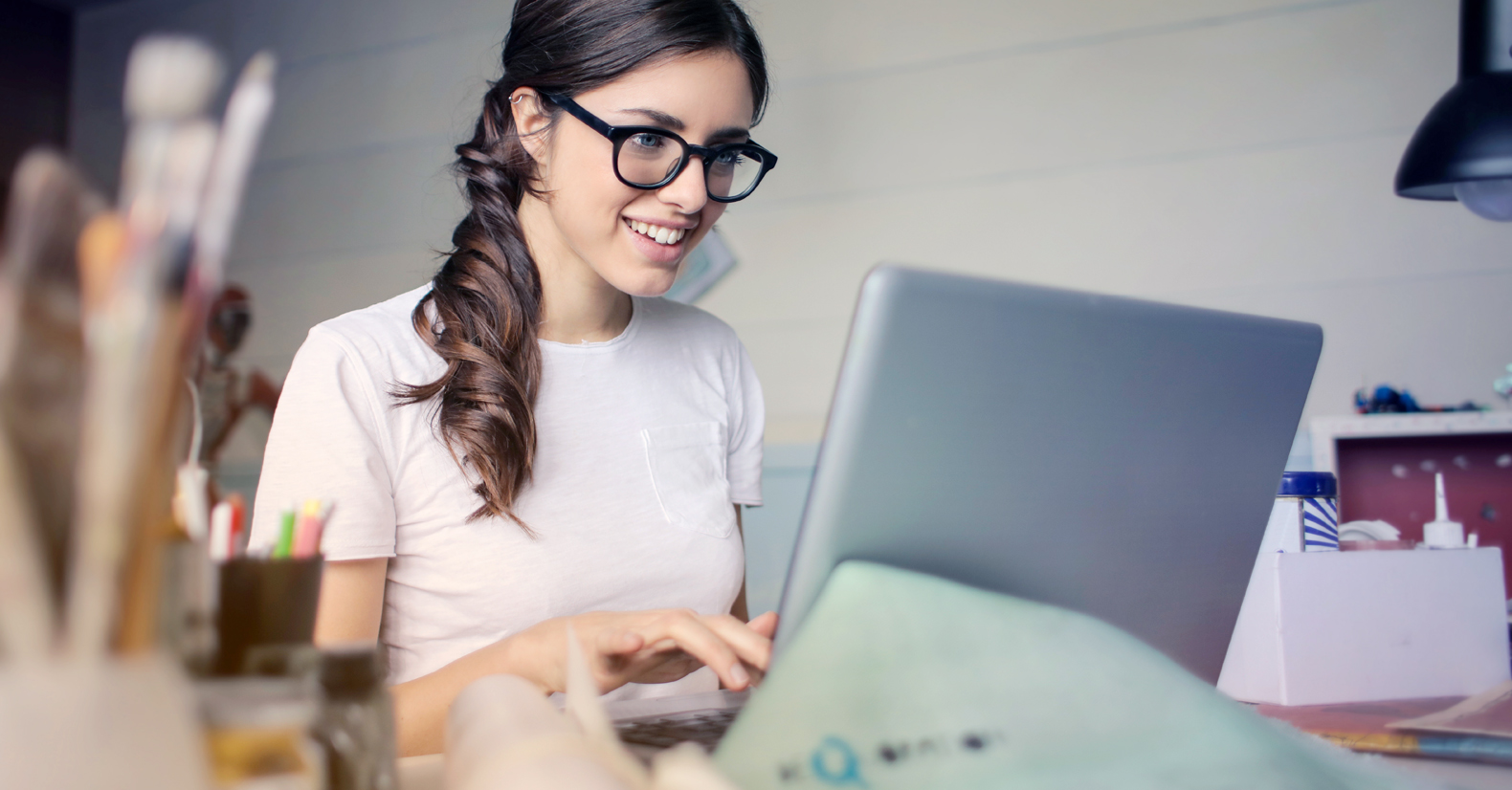 woman in glasses using a computer