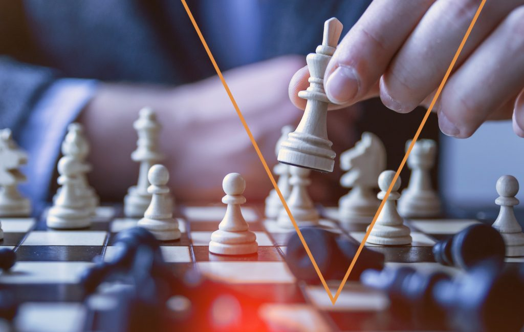Small business website mistakes person playing chess