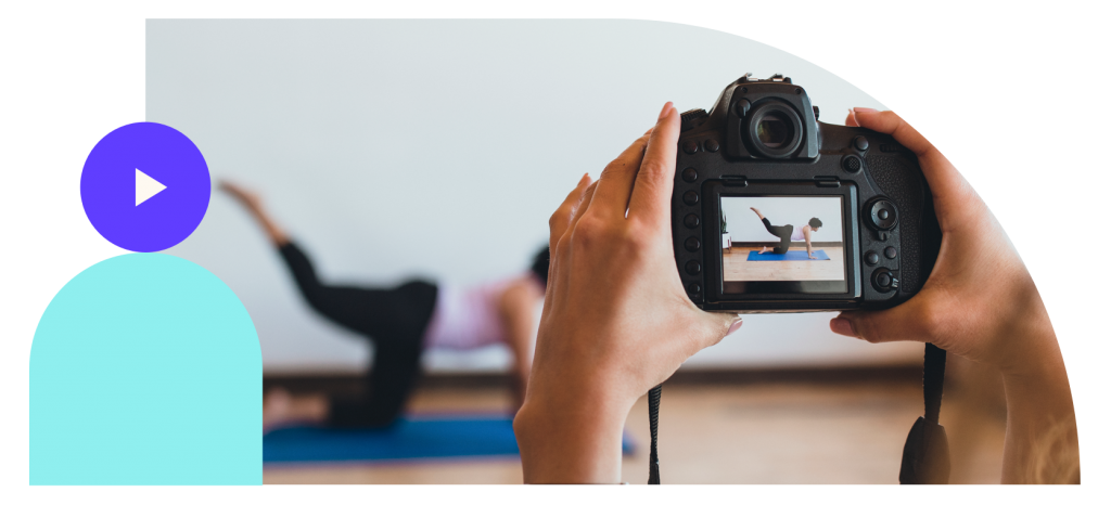 Person creating video content doing yoga in front of the camera
