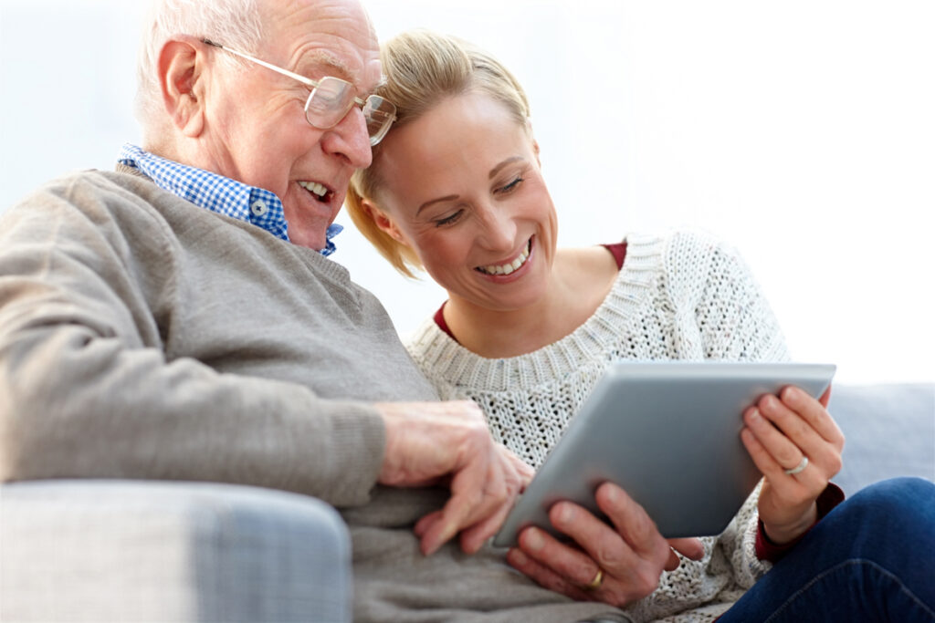 Senior man and woman on tablet