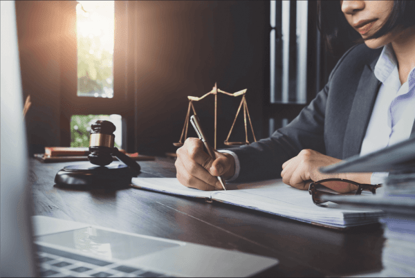 Lawyer writing at desk