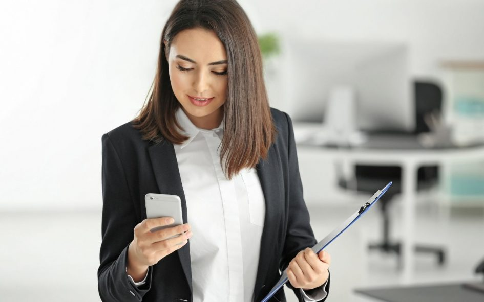 Lawyer looking at phone to calculate call volume