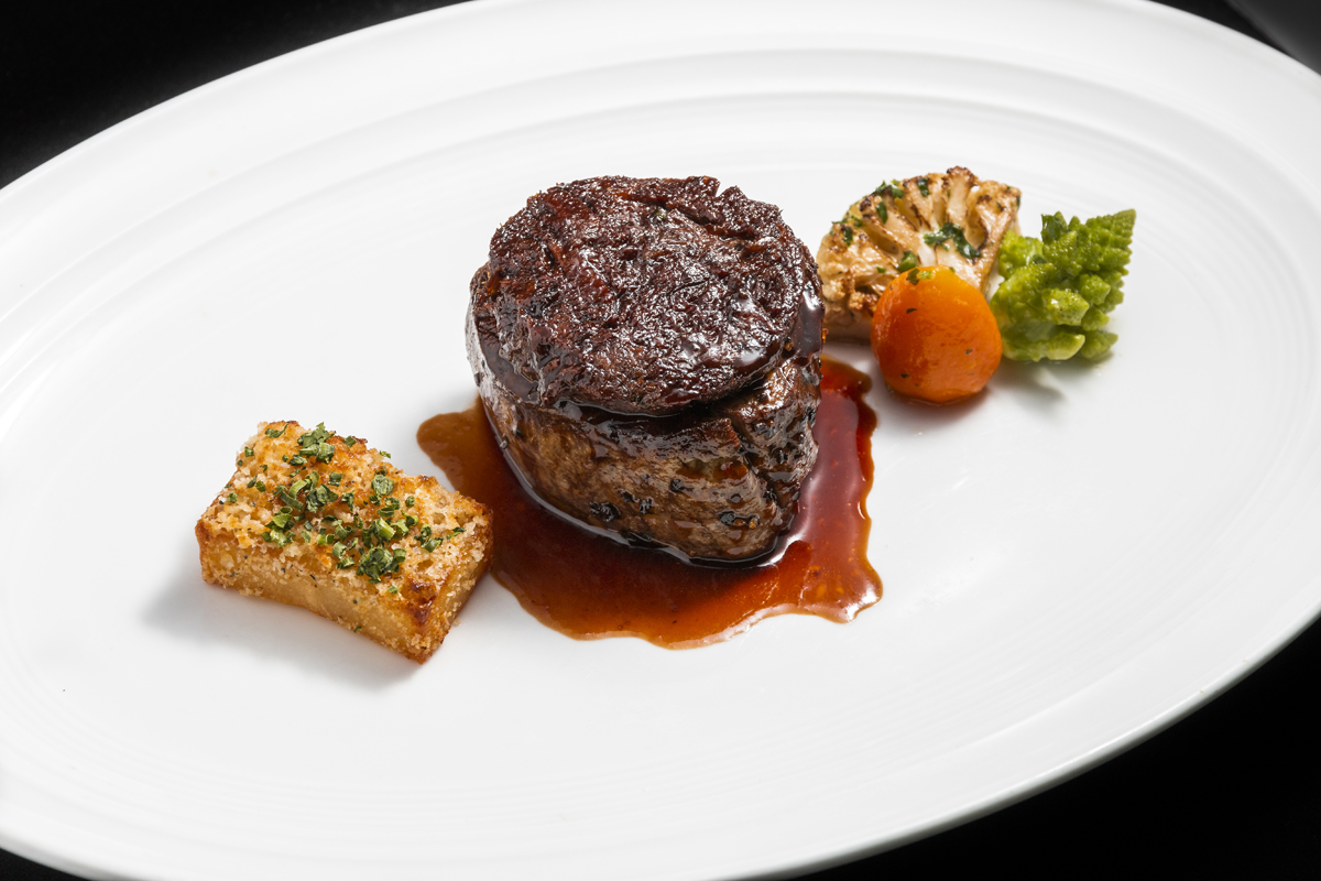 Prime filet mignon with potatoes and vegetables