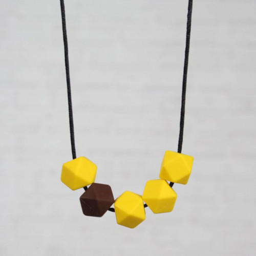 HALSKETTING SILICONE geel + bruin