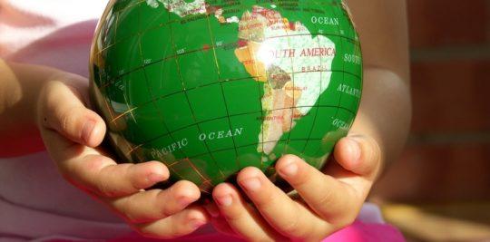 Kid holding the world