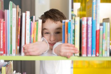 boy-reading-in-library keep kids learning over summer