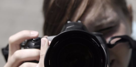 girl-with-camera-750