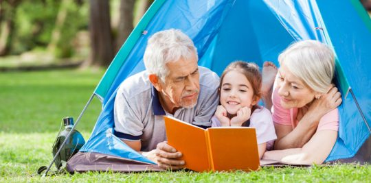 grandparents-reading-to-girl
